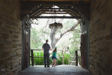 dad_and_daughter_green_trees_summer_hotel_framed_by_doorway_greune_texas| daddy's girl_by Eileen Critchley
