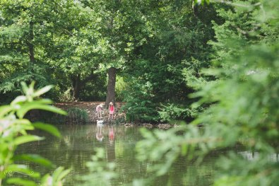 two_girls_across_pond_san_antonio_botanical_garden | making new friends_by Eileen Critchley